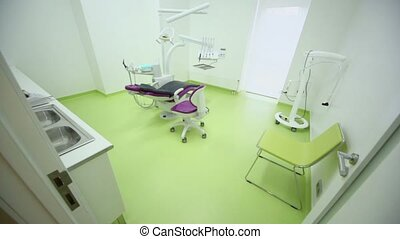 Dental surgery with tv set above medical equipment