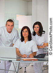 Dental team at a laptop