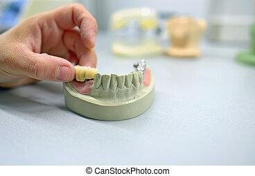 Dental technician working in  laboratory