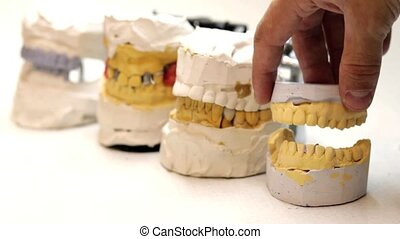 Dental technician workplace. Cast of a jaw.