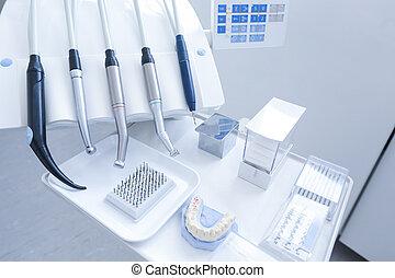 Dental treatment tools with nozzles