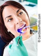 Dental treatment with UV lamp