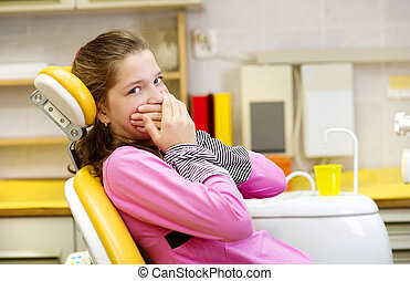 Dental visit - Little girl is being scared at the dentist