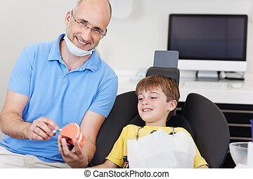 Dentalcare lesson - Little boy gets a dentalcare lesson from...