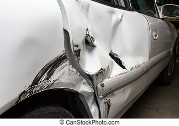 Car after a wreck needing to be repaired waiting for it's insurance claim