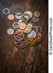denti, monete, ingranaggi