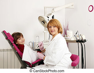 dentist and little girl in dentist office