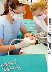 Dentist and nurse curing little girl