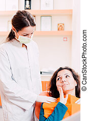Dentist and patient with tooth pain