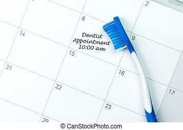 Dentist appointment reminder - Blue toothbrush on dentist...