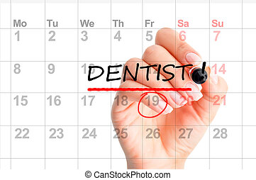 Dentist appointment reminder on calendar planner