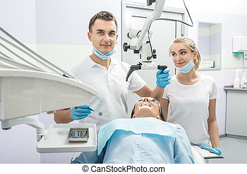 Dentist, assistant and patient in clinic