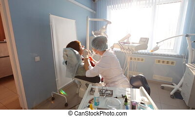 Dentist at work in the office