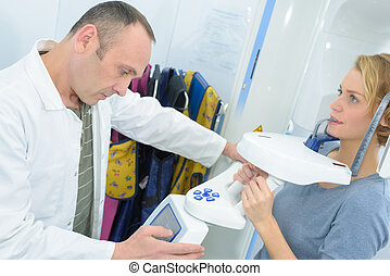 dentist checking results on a patient