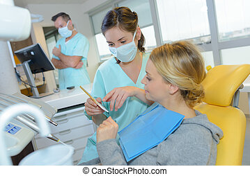 dentist curing a woman patient in the dental office