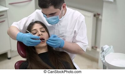 Dentist doctor checking patient teeth