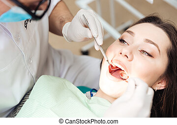 Dentist doing dental treatment to a woman