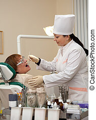 dentist examines mature patient