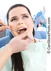 Dentist examines the oral cavity of the patient