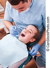 Dentist examines the teeth