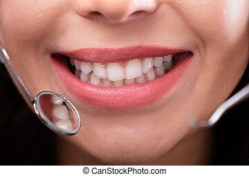 Dentist Examining Teeth