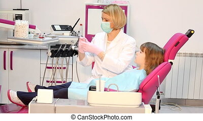 dentist giving an injection to a little girl