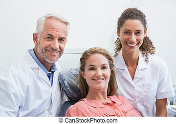 Dentist his assistant and patient