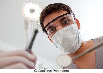 Dentist holding dental tool