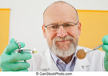 Dentist holding instruments - anesthesic and mirror