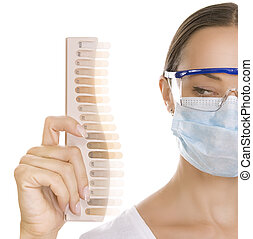 Dentist  holding Palette for tooth color, color matching and tee