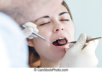 dentist in a dental clinic. The girl on reception at the dentist's chair.