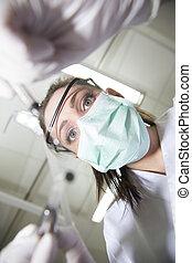Dentist in action