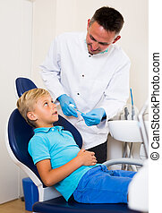 Dentist in white is telling about healthcare in hospital.