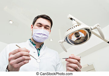 Dentist leaned over the patient. Inspection tool
