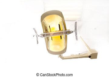Dentist Light - A dentist light or lamp against the ceiling...