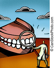 Dentist looking at giant dentures through a magnifier