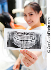 Dentist looking at x-ray picture