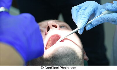 Dentist making anesthetic injection, close up