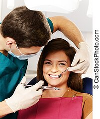 Dentist making anesthetic injection to woman patient