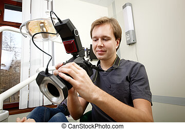 Dentist making photos of patients smile