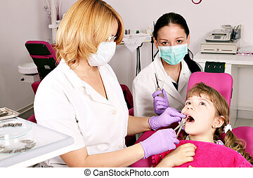 dentist nurse and little girl patient in dental office