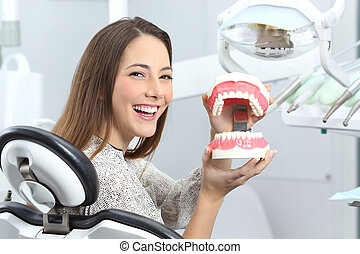 Dentist patient smiling with a plastic denture