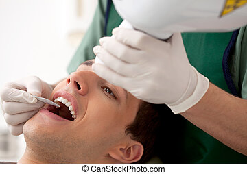 Dentist Preparing X-Ray