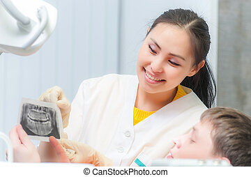 Dentist showing x-ray to a patient