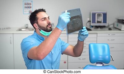 Dentist Studies the X-ray
