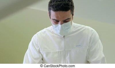 Dentist visiting patient in studio