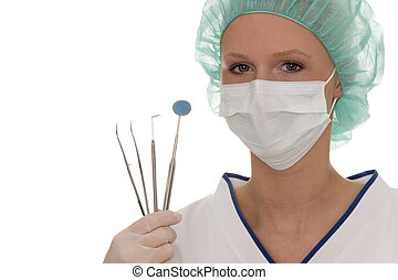 dentist with a few medical instruments in her hand