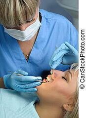 dentist with patient, dental calculus removal