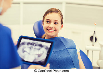 dentist with x-ray on tablet pc and girl patient - people,...
