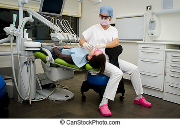 Dentist working on patient in dental clinic